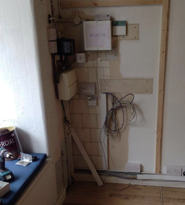 Electrical meter box in an Edinburgh shop before picture